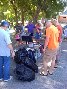 shade tree church praying for recipients of clothes.school supplies